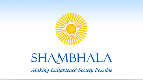 Yellow sun with the words: Shambhala - Making Enlightened Society Possible in blue.