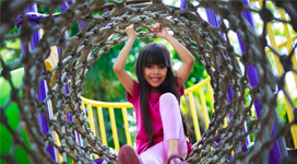 Photo of child on a play set - www.acy.org